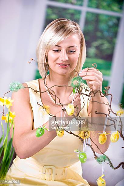 Young woman decorating for Easter
