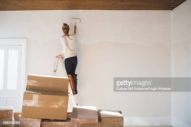 Young woman decorating new home