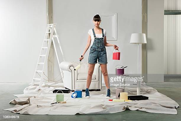 Young woman decorating room