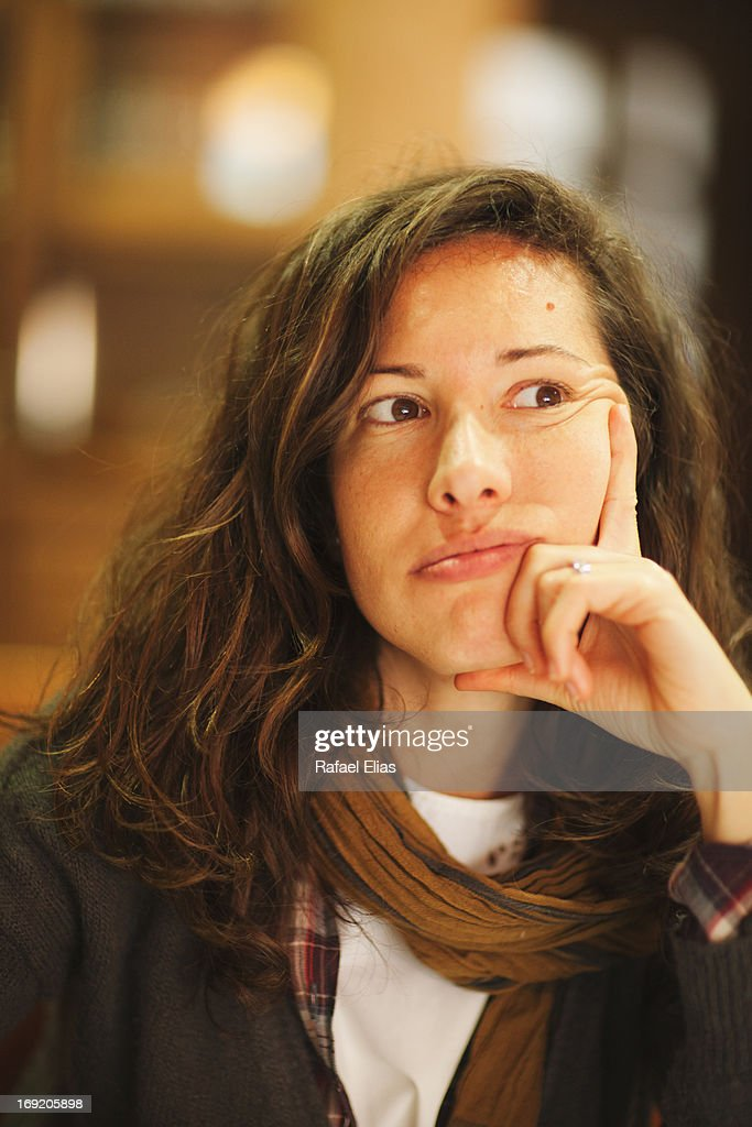 Young woman deep in thoughts : Stock Photo