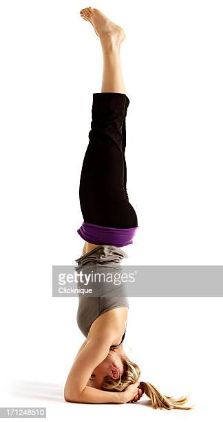 Young woman demostrating Salamba Sirsasana or supported headstand
