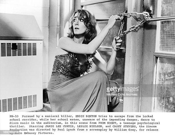 A young woman desperately tries to unhook a lock in a scene from the film 'Prom Night' 1980