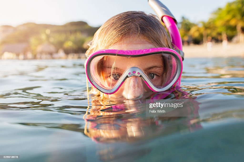 Young woman diving in sea : Stock Photo