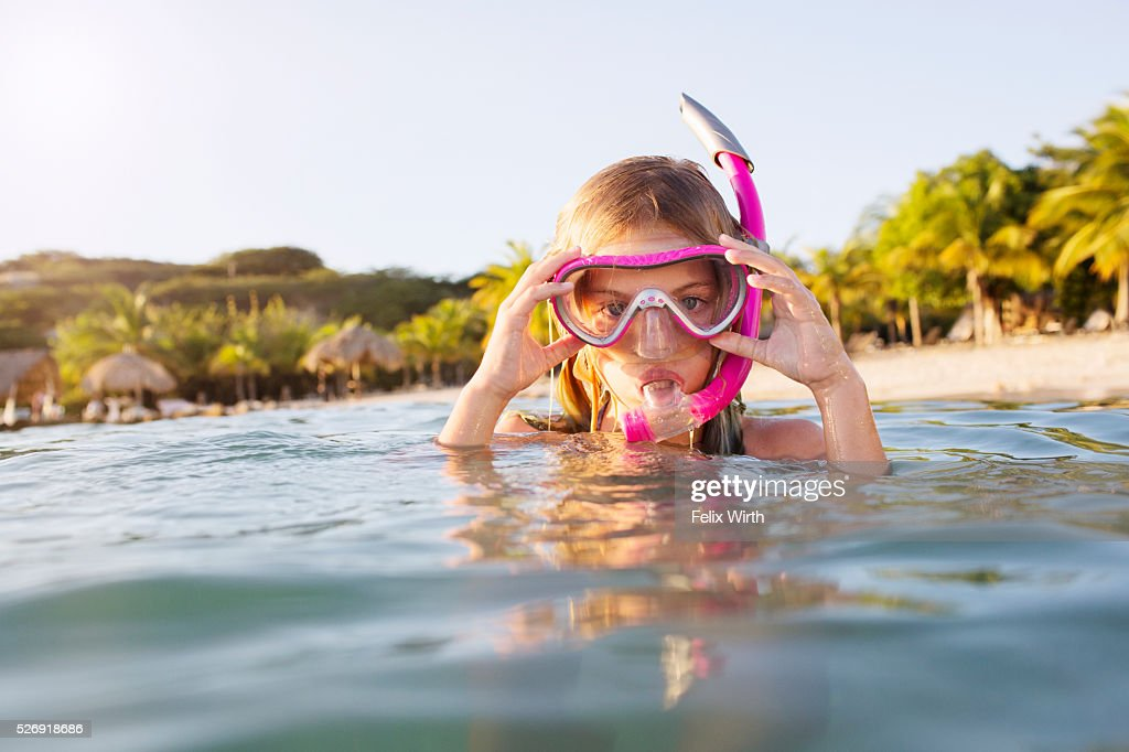 Young woman diving in sea : Bildbanksbilder