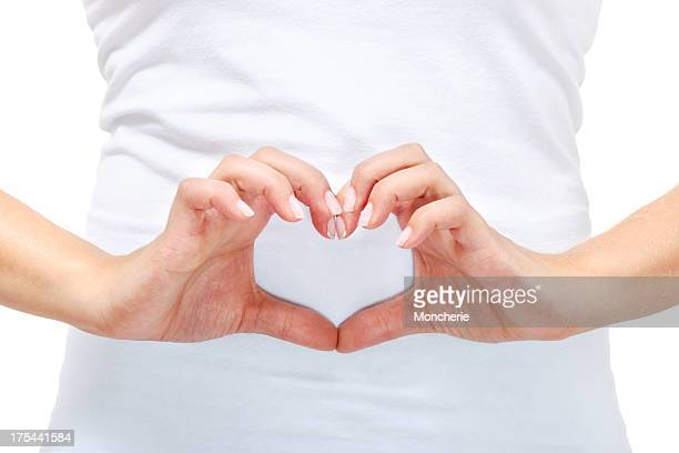 Young woman doing a heart shape