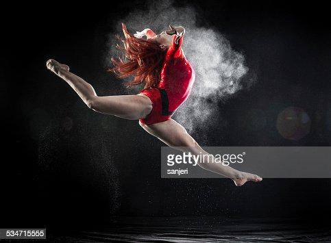 Young woman doing gymnastics jump