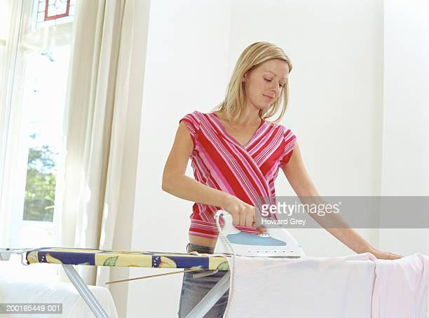 Young woman doing ironing