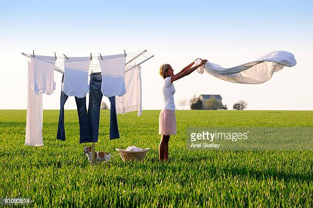 Young Woman Doing Laundry in Field