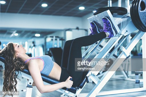 Young woman doing legs workout