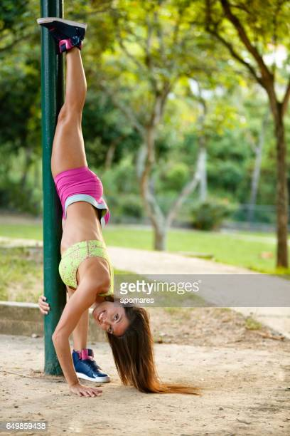 Young woman doing pilates training outdoors in a park