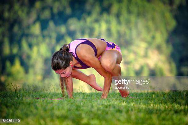 Young woman doing pilates training outdoors in nature