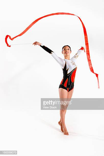 Young woman doing rhythmic gymnastics