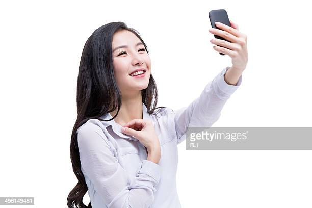 Young woman doing self portrait photography