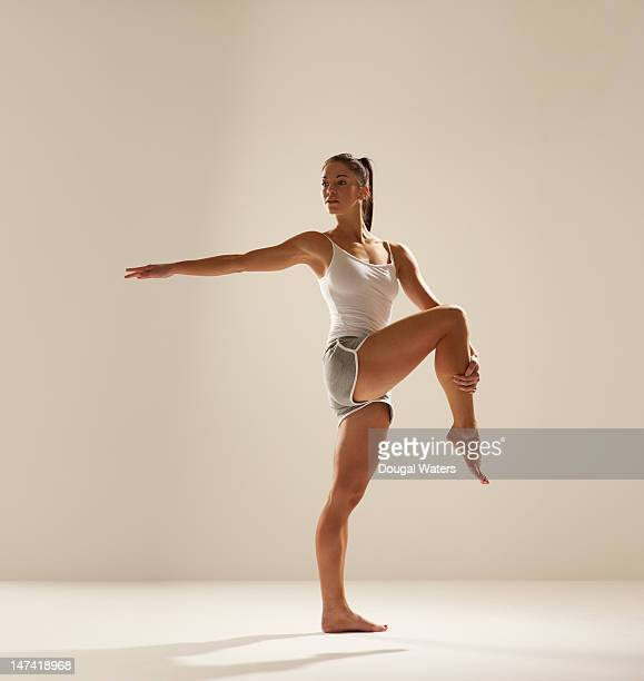 Young woman doing stretches.