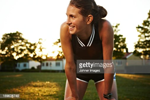 Young woman doing stretching exercises outdoors, Sweden.