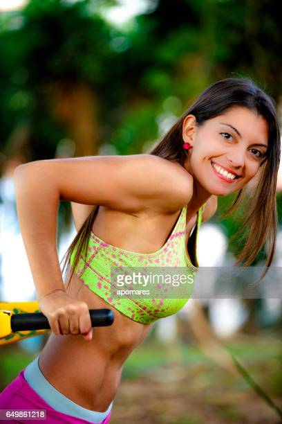 Young woman doing training exercises outdoors in a park