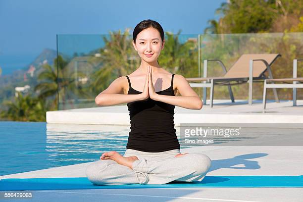 Young Woman Doing Yoga at Seaside