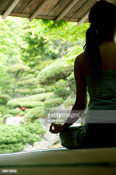 Young woman doing yoga in japanese style room
