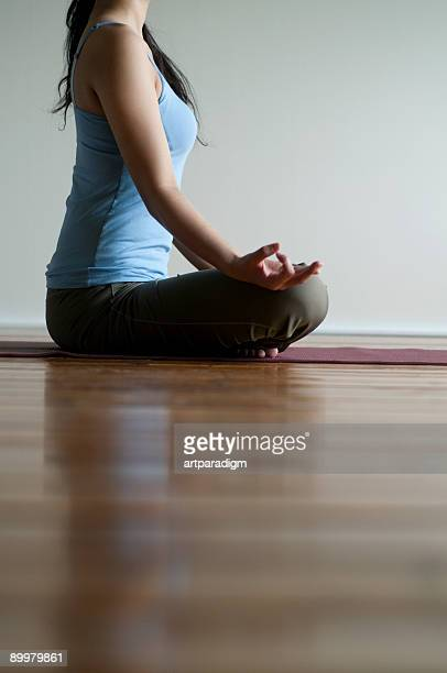 Young woman doing yoga on a floor