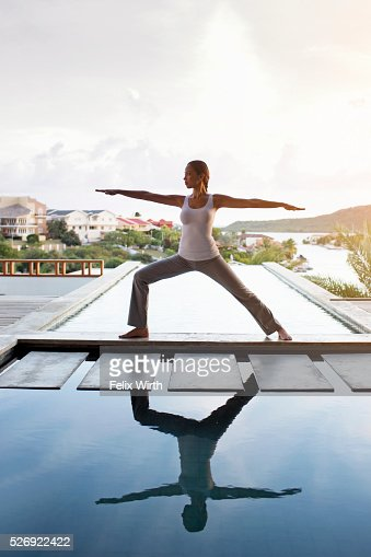 Young woman doing yoga on patio : Bildbanksbilder