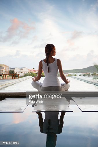 Young woman doing yoga on patio : Photo