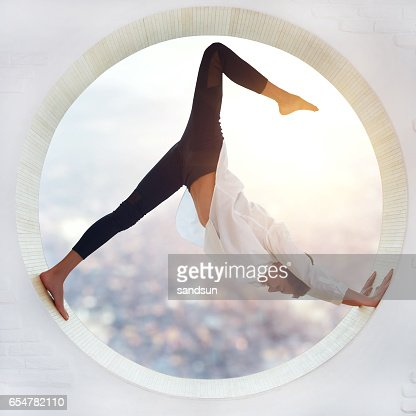 Young woman doing yoga : Stock Photo