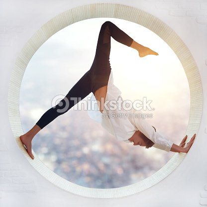 Young woman doing yoga : Stock Photo