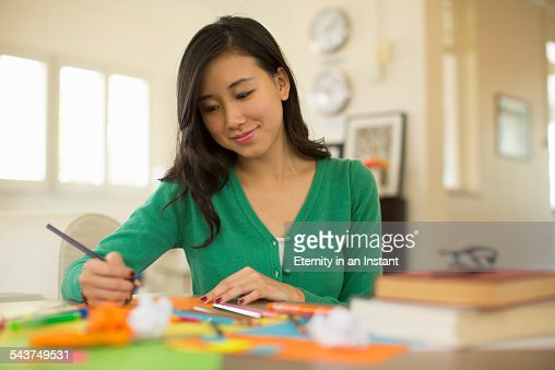 Young woman drawing at home