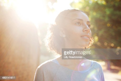 Young woman dreaming in the sun
