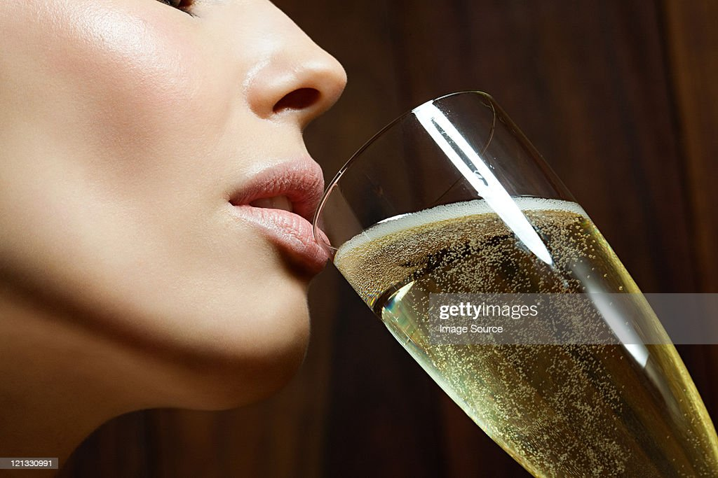 Young woman drinking champagne : Stock Photo