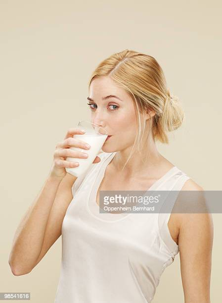 young woman drinking fresh milk