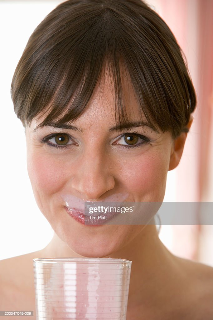 Young Woman drinking fruit smoothie, close-up, portrait : Stock Photo