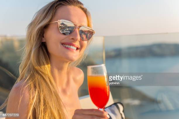 Young woman drinking in a hotel terrace