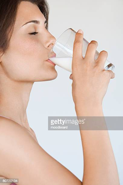 Young Woman Drinking Milk