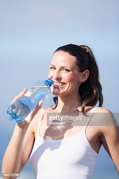 Young woman drinking water, portrait