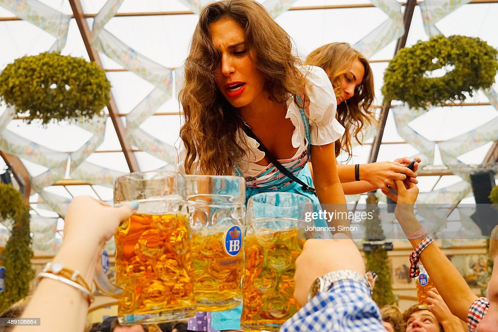 A young woman drinks beer at Hofbraeuhaus beer tent on the opening day of the 2015 Oktoberfest on September 19, 2015 in Munich, Germany. The 182nd Oktoberfest will be open to the public from September 19 through October 4and will draw millions of visitors from across the globe in the world's largest beer fest..