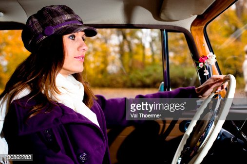 Young woman driving a vintage car, MB 200, built in 1964 : Stock Photo