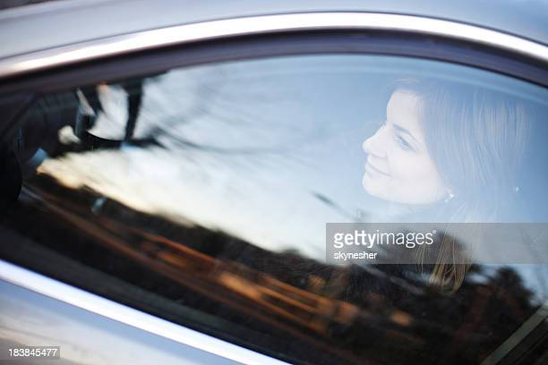 Young woman driving her car.