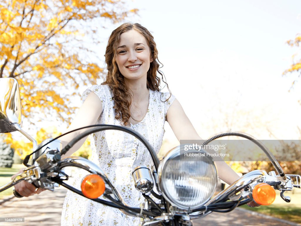 Young woman driving motorcycle : Stock Photo