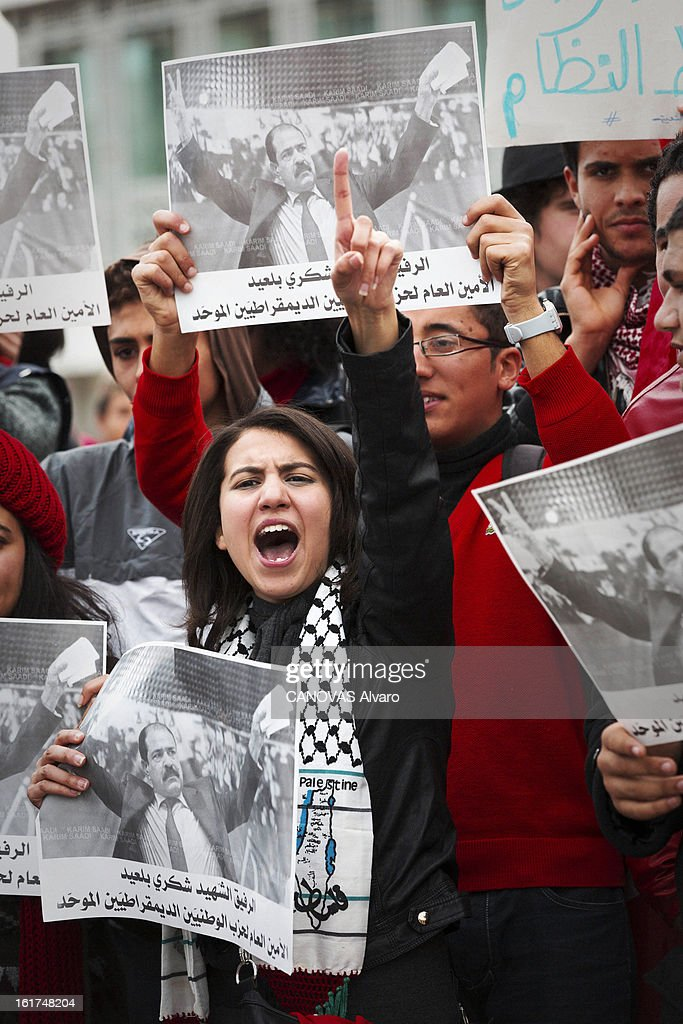 A young woman during a demonstration after the assassination of Chokri Belaid political opponent to the Tunisian government on February 11, 2013 in Tunis,Tunisia.