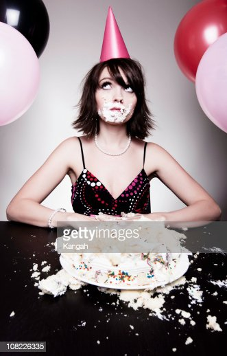 Young Woman Eating Birthday Cake : Stock Photo