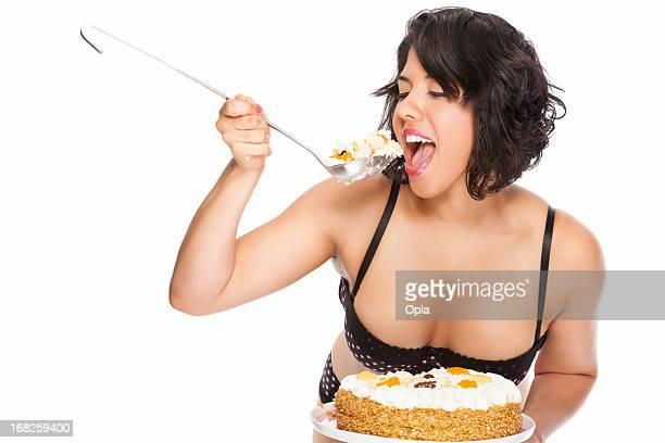 Young woman eating birthday cake
