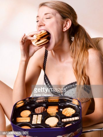 Young woman eating biscuits, close-up