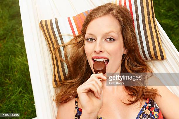 Young woman eating icecream