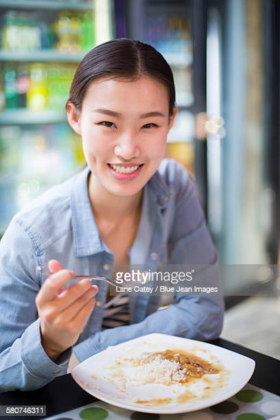 Young woman eating rice