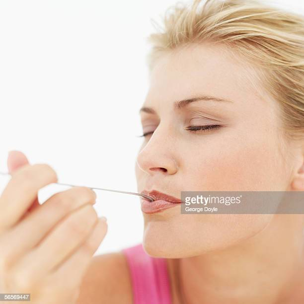 young woman eating with a spoon