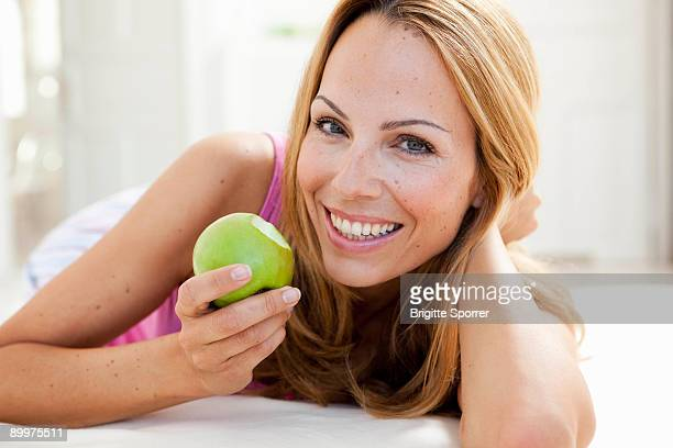 young woman enjoying apple