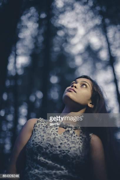 Young woman enjoying fresh air in nature.