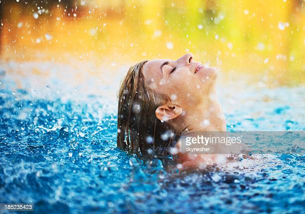 Young woman enjoying in the water.