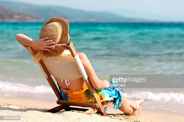Young woman enjoying summer at the beach